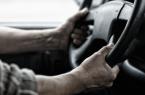 Driver Holding Wheel