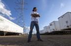 Man in field of semi trailers